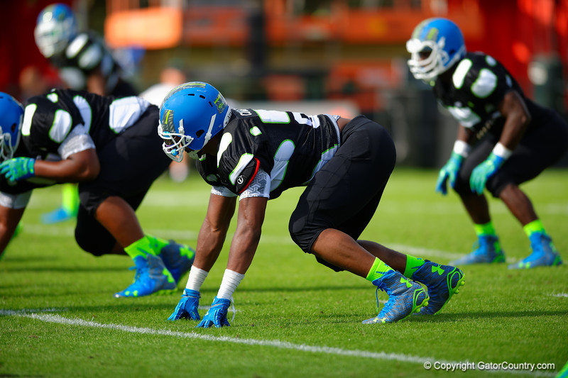 2015 high school football recruit defensive end Byron Cowart runs drills during the first day of practice for the 2015 Under Armour All-America High School Football Game.  2015 Under Armour All-America High School Football Game Practice Day 1.  December 29th, 2014. Gator Country photo by David Bowie.