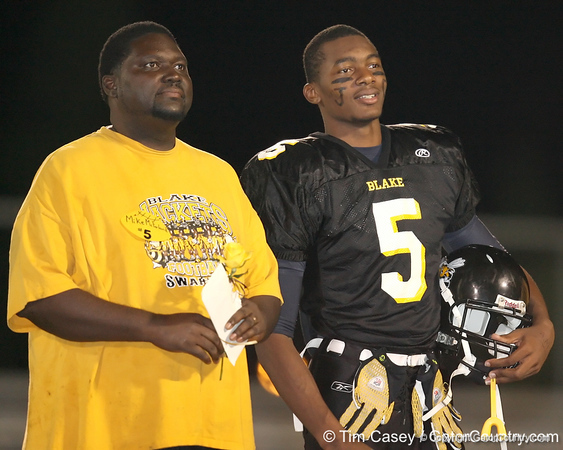 """Calvin Barrs and Tampa (Blake HS) tight end Michael McFarland take part in Senior Day ceremonies before Thomas Jefferson High School's 49-2 win against the Howard W. Blake High School Yellow Jackets on Friday, November 6, 2009 at James """"Big Jim"""" Williams Stadium in Tampa, Fla. / Gator Country photo by Tim Casey"""