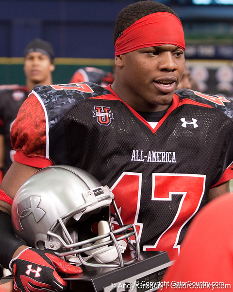 Staten Island, N.Y. (Curtis HS) defensive tackle Dominique Easley holds his MVP trophy after the Under Armour All-America High School Football Game on Jan. 3, 2010 at Tropicana Field in St. Petersburg, Fla. / Gator Country photo by Andy Gregory