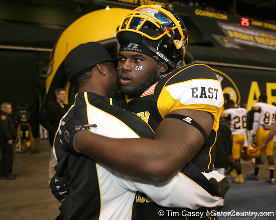 Philadelphia (George Washington HS) defensive tackle Sharrif Floyd hugs a friend during the first half of the U.S. Army All-American Bowl on Saturday, January 9, 2010 at the Alamodome in San Antonio, Texas. / Gator Country photo by Tim Casey