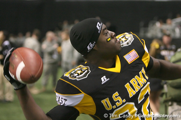 Palm Beach Gardens (Dwyer HS) tight end Gerald Christian throws a football to soldiers after the U.S. Army All-American Bowl on Saturday, January 9, 2010 at the Alamodome in San Antonio, Texas. / Gator Country photo by Tim Casey
