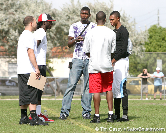 Pahokee (Pahokee HS) wide receiver Chris Dunkley, Miami (Booker T. Washington HS) defensive end Lynden Trail and Miami (Booker T. Washington HS) wide receiver Quinton Dunbar talk during the first tryout for the South Florida Express, held to finalize the squad that will play in the Badger Sport Elite 7on7 tournament, on Sunday, January 24, 2010 at Flamingo Park in Miami Beach, Fla. / Gator Country photo by Tim Casey