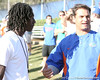 Pahokee (Pahokee HS) wide receiver Chris Dunkley talks with Billy Gonzales after the Gators' sixth day of spring football practice on Friday, April 3, 2009 at the Sanders football practice fields in Gainesville, Fla. / Gator Country photo by Tim Casey