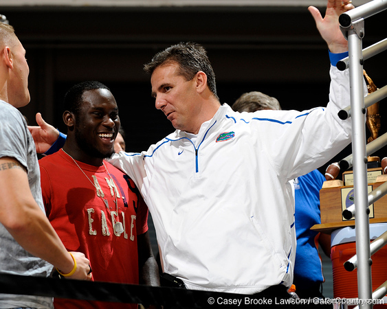 Palm Beach Gardens (Dwyer HS) safety Matt Elam talks with Florida head football coach Urban Meyer during the Gators' men's basketball game against South Carolina on Jan. 23 at the O'Connell Center. / Gator Country photo by Casey Brooke Lawson