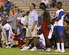 Florida head coach Urban Meyer talks with Moreno Valley, Calif. (Rancho Verde HS) defensive end Ronald Powell and Bradenton (Southeast HS) safety Jonathan Dowling during Friday Night Lights, a one-night football camp at the University of Florida, on Friday, July 24, 2009 at Ben Hill Griffin Stadium in Gainesville, Fla. / Gator Country photo by Tim Casey