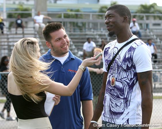 Miami (Booker T. Washington HS) defensive end Lynden Trail talks with Gator Country reporters Laura McKeeman and Justin Wells during the first tryout for the South Florida Express, held to finalize the squad that will play in the Badger Sport Elite 7on7 tournament, on Sunday, January 24, 2010 at Flamingo Park in Miami Beach, Fla. / Gator Country photo by Tim Casey
