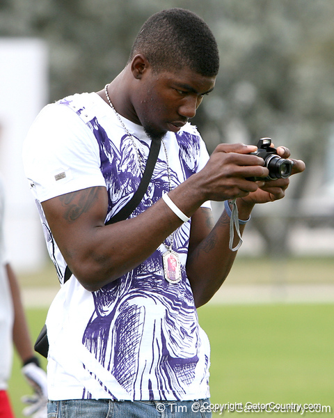 Miami (Booker T. Washington HS) defensive end Lynden Trail makes a photograph during the first tryout for the South Florida Express, held to finalize the squad that will play in the Badger Sport Elite 7on7 tournament, on Sunday, January 24, 2010 at Flamingo Park in Miami Beach, Fla. / Gator Country photo by Tim Casey