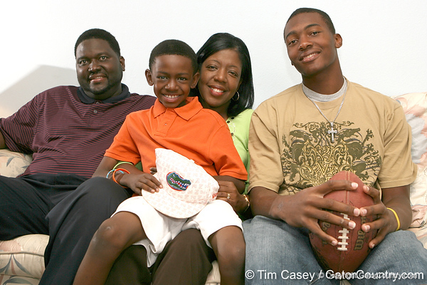 Tampa (Blake HS) tight end Michael McFarland poses for a photo with Calvin, Consandra and Chase Barrs on Monday, May 18, 2009 at the Barrs' home in Tampa, Fla. / Gator Country photo by Tim Casey