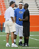 Florida head coach Urban Meyer talks with Nokomis (Venice HS) quarterback Trey Burton and Lithonia, Ga. (King HS) running back Mack Brown during Friday Night Lights, a one-night football camp at the University of Florida, on Friday, July 24, 2009 at Ben Hill Griffin Stadium in Gainesville, Fla. / Gator Country photo by Tim Casey