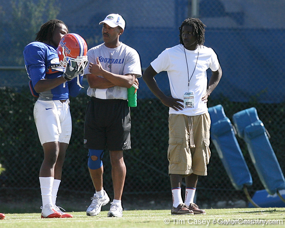 Pahokee (Pahokee HS) wide receiver Chris Dunkley listens as Florida sophomore cornerback Janoris Jenkins talks with cornerbacks coach Vance Bedford during the Gators' sixth day of spring football practice on Friday, April 3, 2009 at the Sanders football practice fields in Gainesville, Fla. / Gator Country photo by Tim Casey