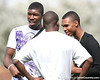 Miami (Booker T. Washington HS) defensive end Lynden Trail talks with friends during the first tryout for the South Florida Express, held to finalize the squad that will play in the Badger Sport Elite 7on7 tournament, on Sunday, January 24, 2010 at Flamingo Park in Miami Beach, Fla. / Gator Country photo by Tim Casey