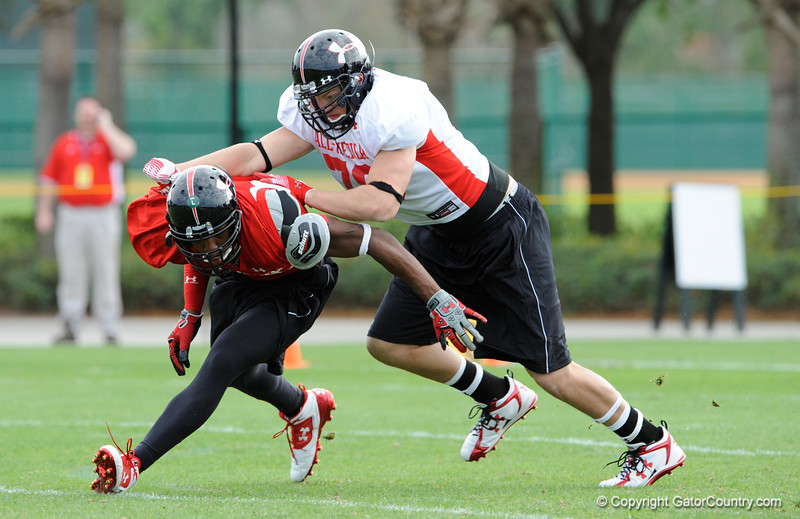 Photo by Casey Brooke Lawson<br /> <br /> Michigan commitment Taylor Lewan makes a block works out during the third day of practice leading up to the Under Armour All-America Game on Friday, January 2, 2009 at Disney's Wide World of Sports Complex in Lake Buena Vista, Fla.