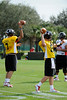 Photo by Casey Brooke Lawson<br /> <br /> Minnesota commitment Moses Alipate (#7) and UCLA commitment Richard Brehaut (#12) warm up before the third day of practice leading up to the Under Armour All-America Game on Friday, January 2, 2009 at Disney's Wide World of Sports Complex in Lake Buena Vista, Fla.