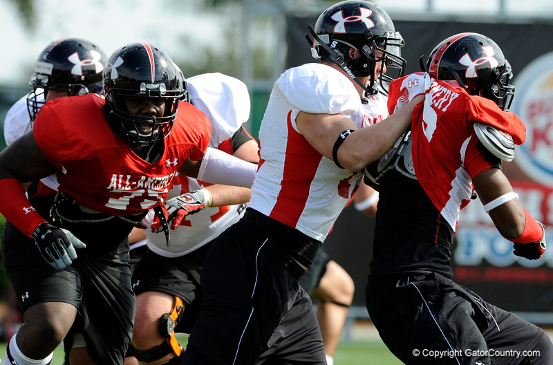 Photo by Casey Brooke Lawson<br /> <br /> Florida commitment Gary Brown breaks through the line during the third day of practice leading up to the Under Armour All-America Game on Friday, January 2, 2009 at Disney's Wide World of Sports Complex in Lake Buena Vista, Fla.