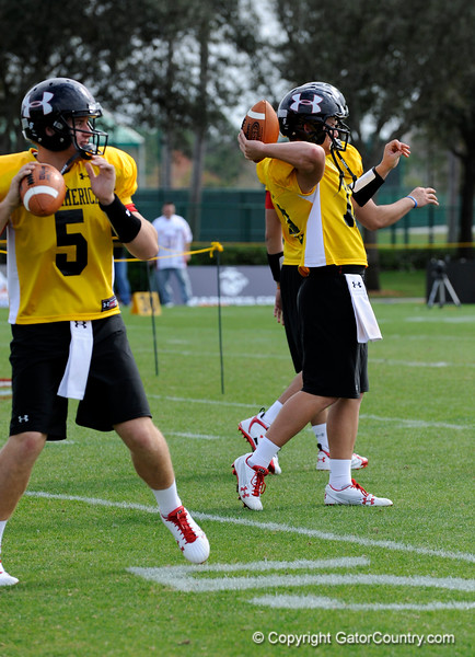 Photo by Casey Brooke Lawson<br /> <br /> USC commitment Matt Barkley (#5) and UCLA commitment Richard Brehaut (#12) warm up before the third day of practice leading up to the Under Armour All-America Game on Friday, January 2, 2009 at Disney's Wide World of Sports Complex in Lake Buena Vista, Fla.