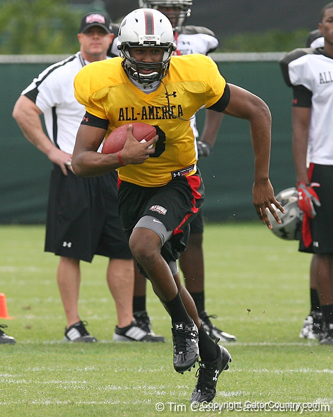 photo by Tim Casey<br /> <br /> Team Click-Clack quarterback EJ Manuel (Virginia Beach, Va. - Florida State commitment) works out at the first day of practice for the Under Armour All-America High School Football Game on Monday, December 31, 2007 at Disney's Wide World of Sports Complex in Lake Buena Vista, Fla. The game will be played on Jan. 5, 2008.
