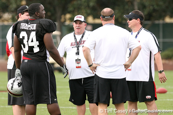 photo by Tim Casey<br /> <br /> Team Click-Clack defensive tackle Brandon Thompson (Thomasville, Ga. - no commitment) talks with coaches at the first day of practice for the Under Armour All-America High School Football Game on Monday, December 31, 2007 at Disney's Wide World of Sports Complex in Lake Buena Vista, Fla. The game will be played on Jan. 5, 2008.