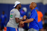 Florida Gators defensive back Marcus Maye and former Gators quarterback Chris Leak shake hands as the Gators host their annual Friday Night Lights camp at Ben Hill Griffin Stadium and Indoor Practice Facility.  July 22nd, 2016.  Gator Country Photo by David Bowie.
