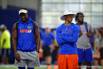 Florida Gators wide receiver Freddie Swain and Florida Gators defensive back Marcell Harris watch on as the Gators host their annual Friday Night Lights camp at Ben Hill Griffin Stadium and Indoor Practice Facility.  July 22nd, 2016.  Gator Country Photo by David Bowie.