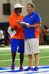 Florida Gators head coach Jim McElwain and Florida Gators defensive backs coach Torrian Gray chatting at mid-field as the Gators host their annual Friday Night Lights camp at Ben Hill Griffin Stadium and Indoor Practice Facility.  July 22nd, 2016.  Gator Country Photo by David Bowie.