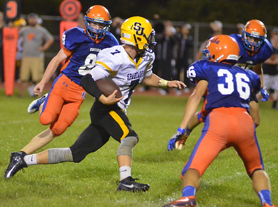 KYLE MENNIG - ONEIDA DAILY DISPATCH Oneida's defenders move in to tackle South Jefferson's Caleb Beach (7) during their game in Oneida on Friday, Sept. 9, 2016.