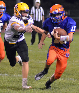 KYLE MENNIG - ONEIDA DAILY DISPATCH Oneida's Tanner Williams (10) tries to escape a tackle by South Jefferson's Joey Kealy (21) during their game in Oneida on Friday, Sept. 9, 2016.