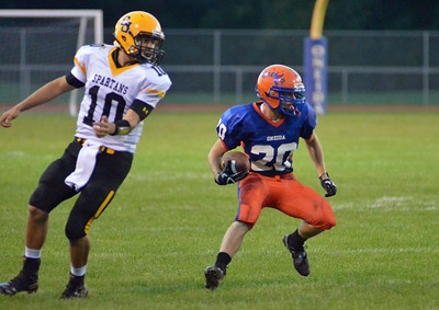 KYLE MENNIG - ONEIDA DAILY DISPATCH Oneida's Tucker Rodgers (20) cuts to the inside to avoid South Jefferson's Brendon Levac (10) during their game in Oneida on Friday, Sept. 9, 2016.