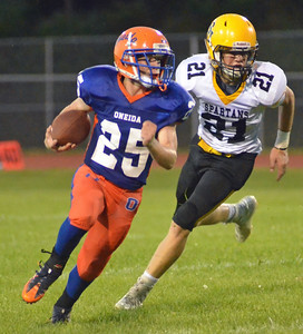 KYLE MENNIG - ONEIDA DAILY DISPATCH Oneida's Lukas Albro (25) breaks a run to the outside, escaping an attempted tackle by South Jefferson's Joey Kealy (21) during their game in Oneida on Friday, Sept. 9, 2016. Albro ran 21 yards for a touchdown on the play.