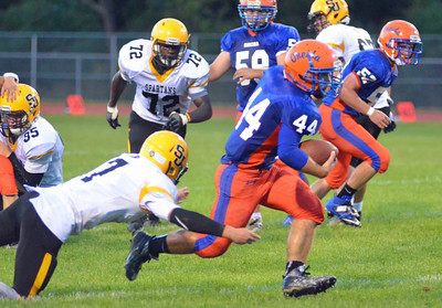 KYLE MENNIG - ONEIDA DAILY DISPATCH Oneida's Kaleb Albro (44) carries the ball as South Jefferson's Caleb Beach (7) tries to make the tackle during their game in Oneida on Friday, Sept. 9, 2016. Albro ran 14 yards for a touchdown on the play.