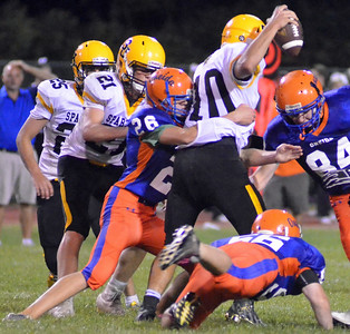 KYLE MENNIG - ONEIDA DAILY DISPATCH Oneida's Griffin Candee (26) wraps up South Jefferson's Brendon Levac (10) during their game in Oneida on Friday, Sept. 9, 2016.