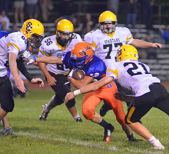 KYLE MENNIG - ONEIDA DAILY DISPATCH Oneida's Drew Grems (12) is wrapped up by South Jefferson's Joey Kealy (21) during their game in Oneida on Friday, Sept. 9, 2016.