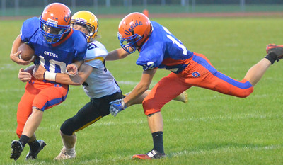 KYLE MENNIG - ONEIDA DAILY DISPATCH Oneida's Tanner Williams (10) is tackled by South Jefferson's Joey Kealy (21) during their game in Oneida on Friday, Sept. 9, 2016.