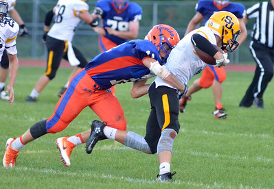 KYLE MENNIG - ONEIDA DAILY DISPATCH Oneida's Nate Lombardi (11) wraps up a South Jefferson ballcarrier during their game in Oneida on Friday, Sept. 9, 2016.