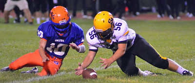 KYLE MENNIG - ONEIDA DAILY DISPATCH Suth Jefferson's Hunter Maitland (56) recovers a fumble in front of Oneida's Tanner Williams (10) during their game in Oneida on Friday, Sept. 9, 2016.