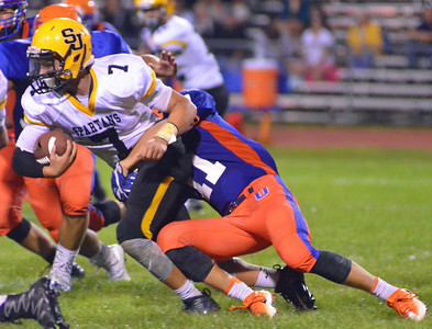 KYLE MENNIG - ONEIDA DAILY DISPATCH Oneida's Nate Lombardi (11) wraps up South Jefferson's Caleb Beach (7) during their game in Oneida on Friday, Sept. 9, 2016.