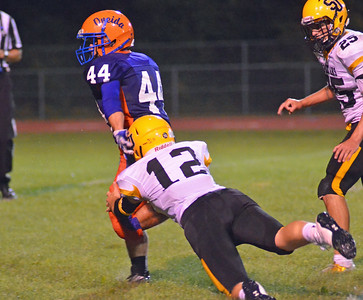 KYLE MENNIG - ONEIDA DAILY DISPATCH Oneida's Kaleb Albro (25) breaks a tackle by South Jefferson's Hunter Benjamin (12) during their game in Oneida on Friday, Sept. 9, 2016. Albro ran 14 yards for a touchdown on the play.