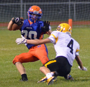 KYLE MENNIG - ONEIDA DAILY DISPATCH Oneida's Tucker Rodgers (20) jukes South Jefferson's Chris Perkins (4) during their game in Oneida on Friday, Sept. 9, 2016.