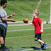 Wesley Cyganiewicz, 8, participates in drills during football camp at Doyle Field on Friday morning. SENTINEL & ENTERPRISE / Ashley Green