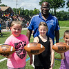 Halle Kendall, Kaleigh Fuller and Sophia Borges were awarded footballs from Leominster High coach Mike Austin for their hard work during football camp at Doyle Field on Friday morning. SENTINEL & ENTERPRISE / Ashley Green