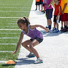 Sophia Borges, 7, participates in drills during football camp at Doyle Field on Friday morning. SENTINEL & ENTERPRISE / Ashley Green