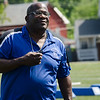 Leominster High coach Mike Austin speaks with the kids during football camp at Doyle Field on Friday morning. SENTINEL & ENTERPRISE / Ashley Green