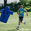 Jake Tocci, 12, participates in drills during football camp at Doyle Field on Friday morning. SENTINEL & ENTERPRISE / Ashley Green