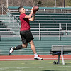 Fitchburg High School sophomore Anthony Oquendo makes a nice catch while playing a little football at Fitchburg State University on Thursday, March 27, 2020 with fellow classmates and friends. SENTINEL & ENTERPRISE/JOHN LOVE