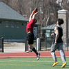 Fitchburg High School sophomore Anthony Oquendo makes a nice catch while playing a little football at Fitchburg State University on Thursday, March 27, 2020 with fellow classmates and friends. Covering him, on right, is FHS's Richard Santana. SENTINEL & ENTERPRISE/JOHN LOVE