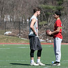 Going over what pass pattern they where going to run is FHS's sophomore Nathan Acker, on left, and freshman Alex Oquendo as they played a little football at Fitchburg State University's Elliot Field Thursday, March 26, 2020. SENTINEL & ENTERPRISE/JOHN LOVE