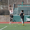 Fitchburg High School sophomore Nathan Acker makes a nice catch while playing a little football at Fitchburg State University on Thursday, March 27, 2020 with fellow classmates and friends. Covering him, on right, is FHS's Richard Santana. SENTINEL & ENTERPRISE/JOHN LOVE