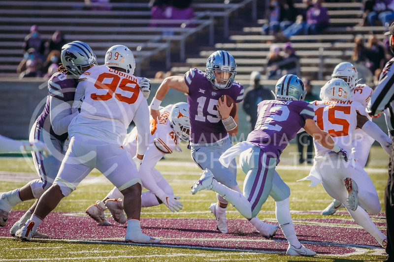 Freshman quarterback Will Howard tries to run past defense during the game on December 5, 2020 game against Texas. (Sophie Osborn | Collegian Media Group)