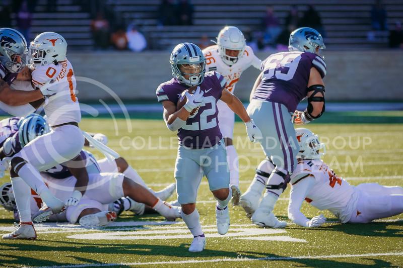 Freshman running back Deuce Vaughn runs the ball during the game on December 5, 2020 game against Texas. (Sophie Osborn | Collegian Media Group)