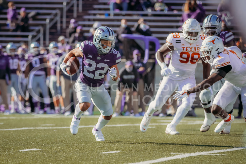 Freshman running back Deuce Vaughn looks to run past defense during the game on December 5, 2020 game against Texas. (Sophie Osborn | Collegian Media Group)