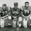 1962 photo of University at Buffalo defensive line football coach Buddy Ryan with starting tackles Gerry Philbin (#73) and Kevin Brinkworth (#71).